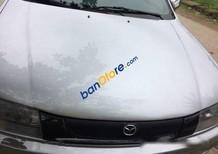 Chính chủ bán Mazda 323 MT đời 1999, màu bạc