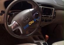 Cần bán Toyota Innova G đời 2014, màu vàng số tự động, 695 triệu