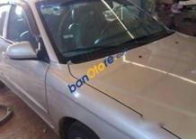 Cần bán xe Kia Spectra MT năm 2004, màu xám, giá tốt