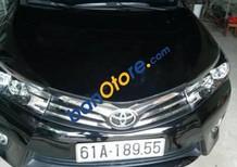 Bán xe Toyota Corolla Altis 1.8 2014, màu đen, xe đẹp như mới, chạy 10.000km, bao test