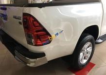 Bán ô tô Toyota Hilux 2.8G 4x4 MT năm 2016, màu trắng, nhập khẩu