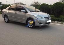 Cần bán Toyota Vios 1.5E đời 2011, màu bạc
