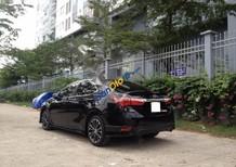 Chính chủ bán Toyota Altis 2.0V form 2015 đăng ký tháng 11/2014, màu đen, biển TP. HCM