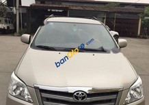 Cần bán Toyota Innova 2.0E đời 2014, màu nâu chính chủ, giá chỉ 710 triệu