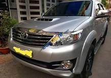 Bán xe Toyota Fortuner 8 chỗ, máy dầu, 12/2015, số sàn, màu bạc, mới 99,9%