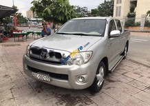 Cần bán Toyota Hilux 2.5E đời 2009, màu bạc, nhập khẩu chính hãng số sàn