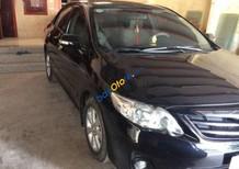 Bán Toyota Corolla Altis cuối 2013, màu đen, xe chính chủ