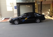 Bán xe Daewoo Magnus đời 2004, màu đen số tự động giá cạnh tranh