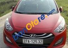 Cần bán xe Hyundai i30 AT đời 2013, màu đỏ đã đi 55000 km, giá 520tr