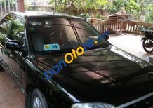 Bán xe Kia Spectra đời 2005, màu đen chính chủ, giá tốt