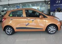 Bán xe Hyundai Grand i10 sản xuất năm 2014, màu vàng, xe nhập