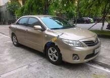 Cần bán lại xe Toyota Corolla XLi 1.6AT đời 2011, màu vàng, nhập khẩu nguyên chiếc
