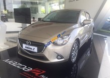 Cần bán xe Mazda 2 sản xuất 2015, màu vàng