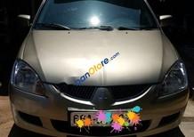 Chính chủ bán xe Mitsubishi Lancer 1.6AT đời 2005, màu vàng