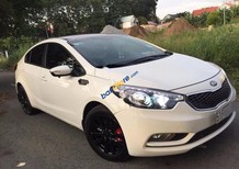 Cần bán lại xe Kia K3 1.6MT đời 2015, màu trắng, sổ bảo hành, bảo dưỡng đầy đủ