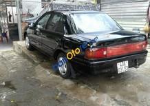 Xe Mazda 323 sản xuất 1995, màu đen, 45 triệu
