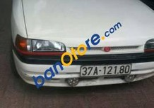 Cần bán Mazda 323 sản xuất 1997, màu trắng, giá tốt