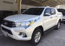 Bán ô tô Toyota Hilux sản xuất năm 2016, màu trắng số sàn