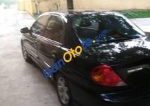 Bán Kia Spectra sản xuất 2004, màu đen, xe còn tốt, ít đi, biển Hà Nội