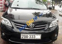 Cần bán Toyota Corolla Altis 1.8 AT đời 2011, màu đen ít sử dụng