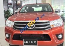 Cần bán xe Toyota Hilux 2.4E MT đời 2017, màu đỏ