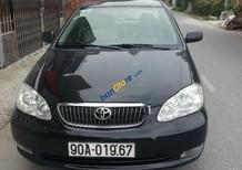 Cần bán xe Toyota Corolla Altis 1.8G MT đời 2006, màu đen chính chủ