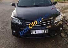 Chính chủ bán Toyota Corolla altis đời 2011, màu đen