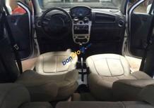 Gia đình bán Chevrolet Spark đời 2010, màu trắng, giá 135tr