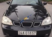 Cần bán gấp Daewoo Lacetti sản xuất 2004, màu đen