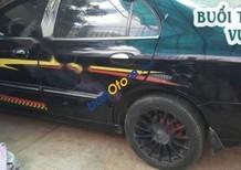 Cần bán lại xe Daewoo Magnus MT đời 2002, màu đen số sàn