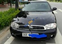Bán xe Kia Spectra năm sản xuất 2006, màu đen, giá 155tr