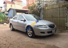 Cần bán Mazda 6 MT năm sản xuất 2004, màu bạc đã đi 15000 km, giá tốt