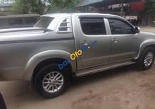 Bán Toyota Hilux sản xuất năm 2014, màu bạc, giá tốt