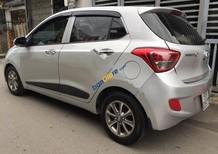 Cần bán gấp Hyundai Grand i10 1.2 AT sản xuất năm 2014, màu bạc, nhập khẩu