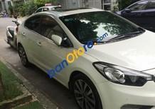 Cần bán gấp xe cũ Kia K3 1.6 AT năm 2014, màu trắng