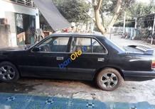 Cần bán gấp Mazda 929 sản xuất năm 1998, màu đen số sàn
