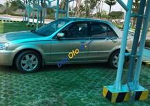 Xe Ford Laser sản xuất 2002, màu vàng, 195 triệu