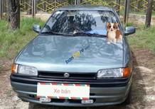 Cần bán gấp Mazda 323 sản xuất 1996, xe nhập
