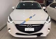 Bán Mazda 2 đời 2015, màu trắng, xe cực đẹp, sơn zin 98%, đăng kí tư nhân đi được 16000 km