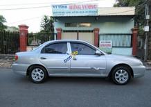 Bán xe Kia Spectra đời 2004, màu bạc, giá rẻ