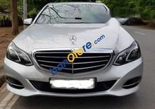 Cần bán Mercedes E200 năm sản xuất 2014, màu bạc