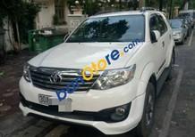 Gia đình cần bán Toyota Fortuner TRD Sportivo 4x2 AT đời 2014, màu trắng