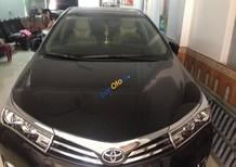Cần bán Toyota Corolla Altis 1.8G AT đời 2015, màu đen, xe một chủ đi giữ gìn, không đâm đụng