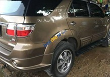 Cần bán xe Toyota Fortuner 2.7V 4x4 AT đời 2011, màu vàng số tự động, 565 triệu