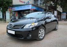 Bán Toyota Corolla Altis 1.8G AT năm sản xuất 2011, màu đen, xe gia đình ít dùng nên còn rất mới