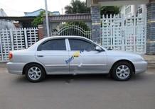 Cần bán gấp Kia Spectra 1.6 MT sản xuất 2004, màu bạc