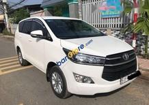 Bán xe cũ Toyota Innova E 2.0 MT năm 2016, màu trắng