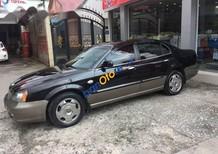 Cần bán gấp Daewoo Magnus đời 2005, màu đen
