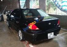 Bán ô tô Kia Spectra đời 2004, màu đen, giá 120tr