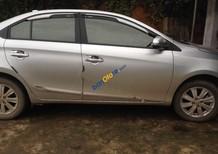 Cần bán Toyota Vios 1.5E đời 2015, màu bạc